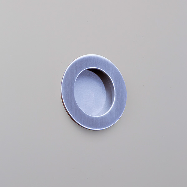 Circular-flush-pull-on-GREY-PAINT