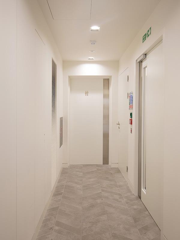 Shadbolt RAL 9016 WC entrance door at 55 Wells Street